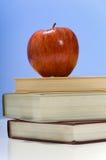 School books and Apple Stock Photos