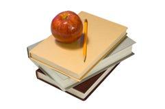 School books and apple Stock Image