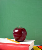 School Books and an Apple Stock Image