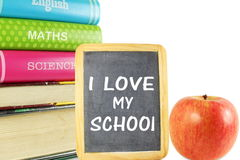 School books with apple and black board back to school Royalty Free Stock Photography