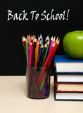 School books with apple on desk Royalty Free Stock Photo