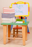 School books and apple on desk with sketchboard Stock Photos