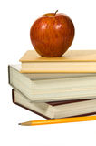 School books and apple white Royalty Free Stock Photos