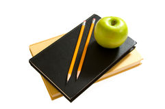 School books and apples Stock Photos