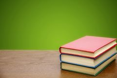 School books on the background of a school board stock image