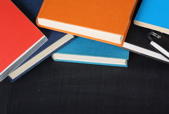 School Books and  a Blackboard Royalty Free Stock Images
