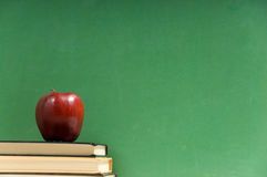 School books and chalkboard Stock Image