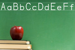 School books and chalkboard Royalty Free Stock Images