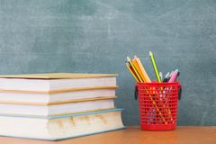 School books on desk, education concept.  royalty free stock images
