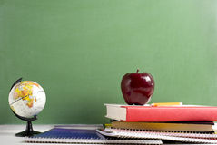 School Books a red Apple and a Globe Stock Photo
