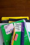 School books, supplies on desk Stock Photography