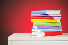 School Books on a White Desk Royalty Free Stock Photos