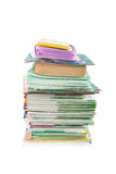 School books and writing-books. Pile of school books and writing-books with a case above isolated on a white background Royalty Free Stock Photography