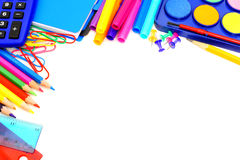 School border. Colorful border of school supplies over a white background Royalty Free Stock Photography