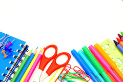 School border. Colorful border of school supplies over a white background royalty free stock image