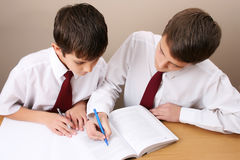 School Boy. Teenage School boy busy with his homework, wearing uniform Stock Photos