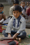 A School boy. A child boy is reading book outside the school in rural India Stock Photos