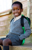School boy. Little guy waiting for the bus, on his way to school royalty free stock photos