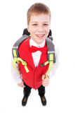 School boy. Portrait of smiling, little boy in school uniform with backpack. Isolated on white background Royalty Free Stock Photos