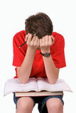 School Boy. A young school boy frustrated about schoolwork Stock Photos