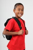 School boy 9 wearing red and happy smile in studio Stock Photo