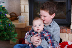 School boy and adorable baby boy indoor with christmas decoratio Royalty Free Stock Photos
