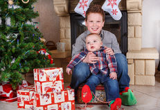 School boy and adorable baby boy indoor with christmas decoratio Royalty Free Stock Image