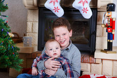 School boy and adorable baby boy indoor with christmas decoratio Royalty Free Stock Photo