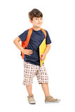 School boy with backpack holding a notebook Royalty Free Stock Image