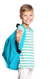 School boy with backpack. Smiling school boy with backpack standing and showing thumb up sign. Smiling child on white background Stock Photo