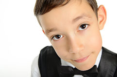 School boy in black suit isolated on white Royalty Free Stock Image