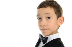 School boy in black suit with isolated on white Royalty Free Stock Photography