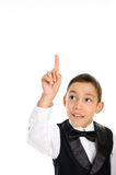 School boy in black suit touching something Stock Image