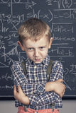 School boy and blackboard Stock Images