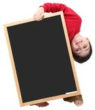 School Boy Blank Sign with Clipping Path. Adorable six year old school boy with blank chalkboard with clipping path over white Stock Photos