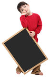 School Boy Blank Sign with Clipping Path. Adorable six year old school boy with blank chalkboard with clipping path over white Royalty Free Stock Photography