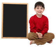 School Boy Blank Sign with Clipping Path. Adorable six year old school boy with blank chalkboard with clipping path over white Royalty Free Stock Image