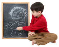 School Boy Blank Sign with Clipping Path. Adorable six year old school boy with drawing on chalkboard with clipping path over white Stock Image