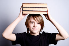School boy with books Stock Images