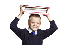School boy with books on his head Stock Image