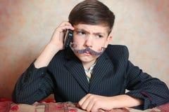 School boy in businessman suit Royalty Free Stock Photos