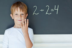 School boy. A child writes on the blackboard Stock Images