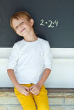 School boy. A child writes on the blackboard Royalty Free Stock Photography