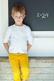 School boy. A child writes on the blackboard Royalty Free Stock Photo