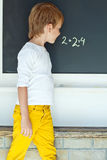 School boy. A child writes on the blackboard Royalty Free Stock Photos