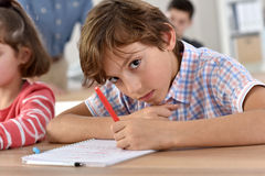 School boy in class writing Royalty Free Stock Photography