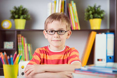 School boy at classroom desk making  schoolwork Royalty Free Stock Photo