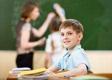School boy in classroom at lesson Royalty Free Stock Image