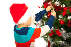 School boy decorate a tree Stock Image