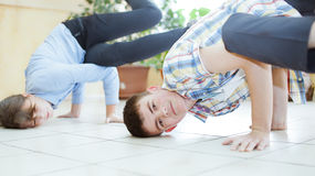 School boy doing back flip on the desk in the classroom Stock Photography